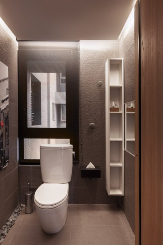 Cool-Taiwan-Home-With-dark-chocolate-bathroom-wall-and-floor-and-white-toilet-and-washbasin-and-big-mirror-and-wooden-cabinet