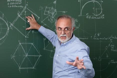 Professor giving class at the blackboard